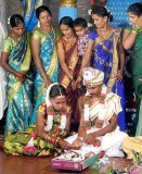Bride and groom with his wedding presents; Wedding ceremony in Karnataka, India