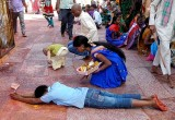 Devotees that have made vows circle round the temple and prostrate every few metres,Yellamma temple,Saundatti,Karnataka, India.