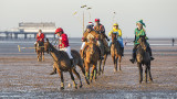 Fancy dress polo on the beach