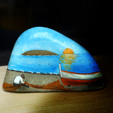 An old man painted on stones...