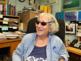 Genie in her office with her Shark sun glasses