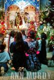 Women praying at the altar