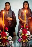 Two Ladies holding velas