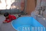 Boy by fountain