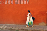 Lady in white walking