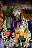 Cristo holding yellow roses