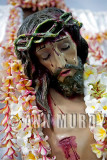 Cristo covered with leis of flor de mayo