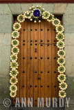 Doorway decorated with hearts of palm coronas