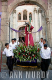 Carrying Cristo out of church courtyard