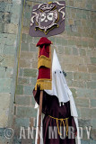 Penitente carrying banner