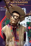Man wearing wooden mask