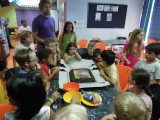 Cutting the cake at his seventh birthday party
