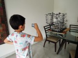 Photographing a second marble roller coaster that Dad made