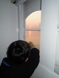Photograping the sunset from below deck