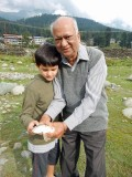 Rahil and Nanu with large rainbow trout