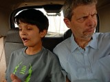 Rahil and Dad clowing around in a taxi