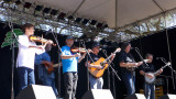Phil Salazar & the Kin Folk enjoy the morning sun at main stage