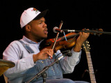 Blind Boy Paxton fiddles at the Main Stage