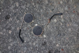 Glasses on tarmac