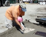 Mixing ashed into wet concrete