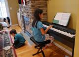 P1120102 Kira at her new keyboard