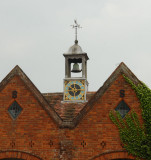 Clock tower and bell on the old stables, now a garage.