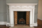 CC035. A period fireplace of 18th  Century - if you ignore the 13amp power sockets