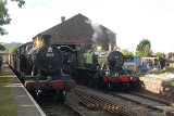 3863 arrives at Dunster from Minehead while 4131 continues to shunter goods stock.