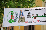 Banner in Tlemcen with the 50th Anniversary of Independence logo and a woman in traditional dress