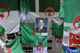 Algerian president surrounded by flags