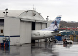 Tail of a First Air B737-400 (C-FFNC) sticking out of the hanger in Iqaluit