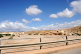 The bridge crosses a broad sandy wadi, a dry riverbed