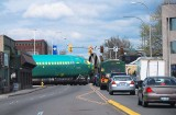 Street traffic waits for part of an airplane