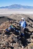 Phoning home from Tetzlaff Peak's summit ridge