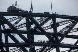 Bridge climbers on two levels