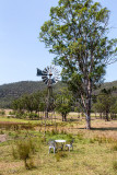 Australian paddock with windmill for drawing water