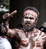 Aboriginal busker with clapsticks