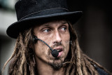 Dreadlocks busker close up
