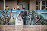 Japanese bride and groom negotiating Opera House steps with construction in background