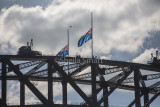 Sydney Harbour Bridge with half mast flags