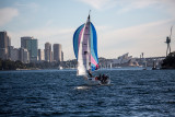 Yacht sailing down Sydney Harbour
