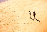 Two on beach at Kaiteriteri