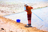 Boy checking his net at Southend