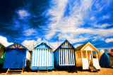 Four beach huts at Southend on Sea, Essex