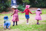 Children at play holding hands
