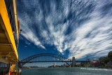 Sydney Harbour Bridge from ferry with magic cirrus clouds