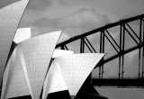 Sydney Opera House with Sydney Harbour Bridge in black and white