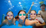 Children swimming underwater - kids having fun