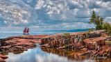 **126.5 - Grand Marais: Schooner Hjørdis Entering Harbor With Gathering Storm