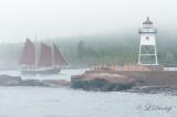 * 126.4 - Grand Marais:  The Schooner Hjørdis Coming Into Harbor With Fog